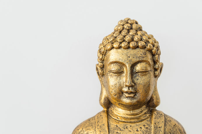 Generic golden statue of Buddha on white