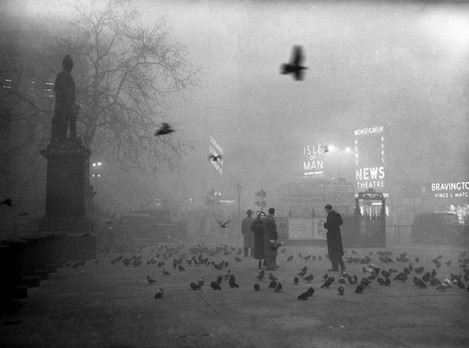 Another image of London, this time in the late 50s. An image that contains somewhat timeless elements (birds, trees, fog, a statue) juxtaposed with the modern (street lights, subway entrances, 24-hour neon signs).