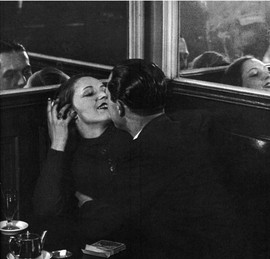Brassaï (1899-1984) chronicled the life of Paris by capturing images of its streets, back alleys, brothels and cabarets. Here, he has created the ultimate modern image of a moment effection: not just the lovers, but their reflections, adding additional content to the main image, as if we are not only witnessing a moment of physical embrace but the separate worlds of memory it produces as well.