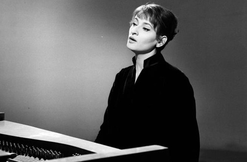 Barbara (1930-1997) was a French chanson singer and singularly one of the greatest influences on my musical output of late. In this iconic image, devoid of any context save for the piano, she creates the world of her song as she parts her lips, regarding it contents and events with a knowing, far-off glance.