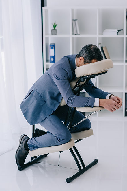 businessman in suit sitting in massage c