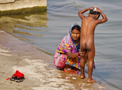 mother bathing son