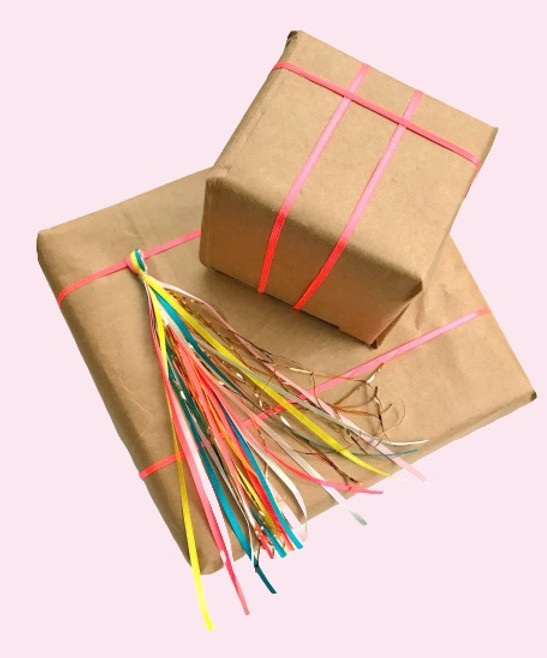 Brown paper wrapping with tinsel and string