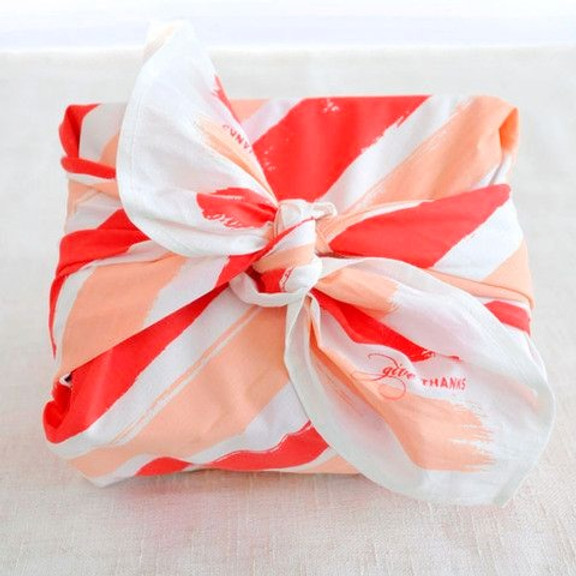 Knotted fabric gift wrapping