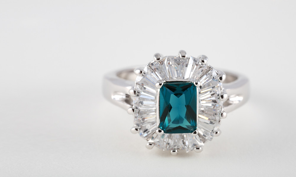 Ring with Claw Fitted Gemstones