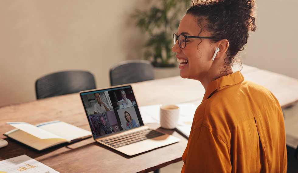 Businesswoman laughing during a video ca