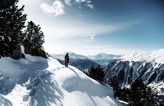 Hiker on an adventure climbing a mountain