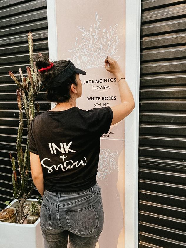 Jade McIntosh Flowers sign painting.jpeg
