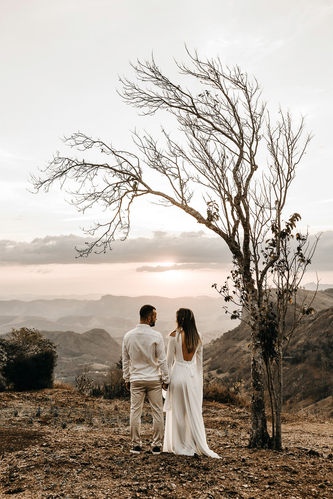 a-couple-in-white-dress-standing-in-view