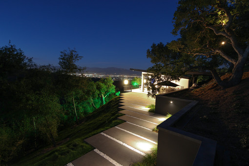 Soraa LED lamps and selective colored theatrical gels were used to create a thematic getaway within the ancient oaks of California. With the interplay of dark and lighting banding created by the inspired landscape design of Dirk Gaudet of Gaudet Design Group, our lighting hits the same repetition in a light and dark rhythmic dance.With a panoramic view of the lights of North Hollywood and the canyon trails of Mulholland, this Guest House features the highest quality LED MR-16 lighting from Soraa and selective colored theatrical gels to create a thematic getaway within the ancient oaks of California.  With the interplay of dark and lighting banding created by the inspired landscape design of Dirk Gaudet of Gaudet Design Group, our lighting hits the same repetition in a light and dark rhythmic dance.