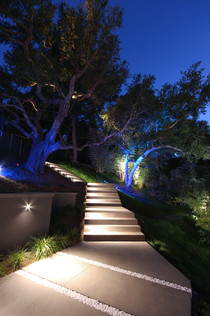 Soraa LED lamps and selective colored theatrical gels were used to create a thematic getaway within the ancient oaks of California. With the interplay of dark and lighting banding created by the inspired landscape design of Dirk Gaudet of Gaudet Design Group, our lighting hits the same repetition in a light and dark rhythmic dance. With a panoramic view of the lights of North Hollywood and the canyon trails of Mulholland, this Guest House features the highest quality LED MR-16 lighting from Soraa and selective colored theatrical gels to create a thematic getaway within the ancient oaks of California.  With the interplay of dark and lighting banding created by the inspired landscape design of Dirk Gaudet of Gaudet Design Group, our lighting hits the same repetition in a light and dark rhythmic dance.
