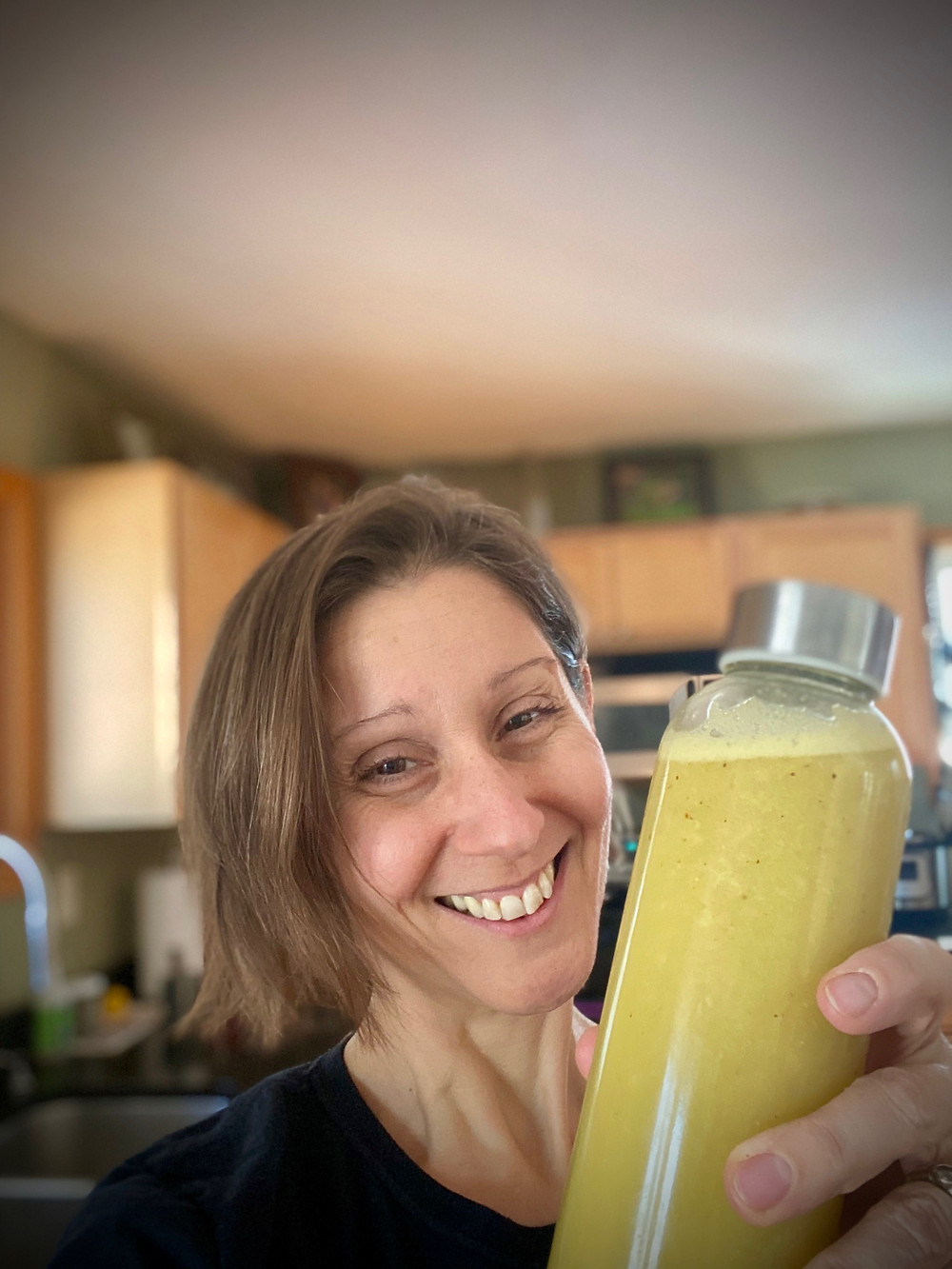 Dr. Patty with jar of star fruit juice