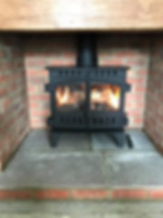 Log burning stove fitted byConsett Gas Stoves & Bathrooms.