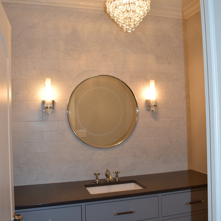 Stylish Half Bath with Marble Backsplash