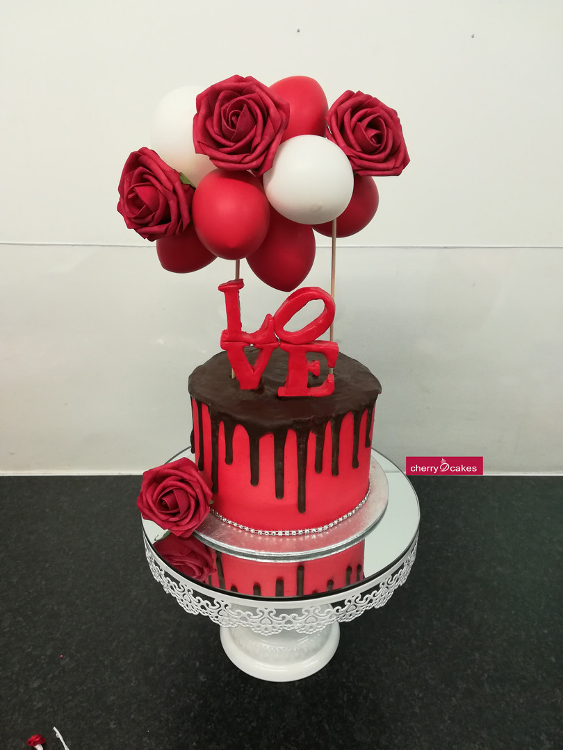 LOVE Drip Balloon Cake