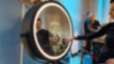 Our guests using the beauty mirror and applying her signature to her photograph on the touch screen
