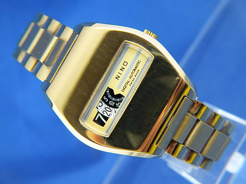 Nino Automatic Jump Hour Swiss Watch . Circa 70s . New Old Stock . Cal AS 2072