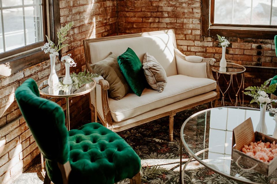 Gold and ivory settee: Modern Greenery Baby Shower at Maggie's on the River featured on Pretty Little Vintage Co.