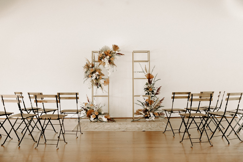 Bistro chairs wedding ceremony setup