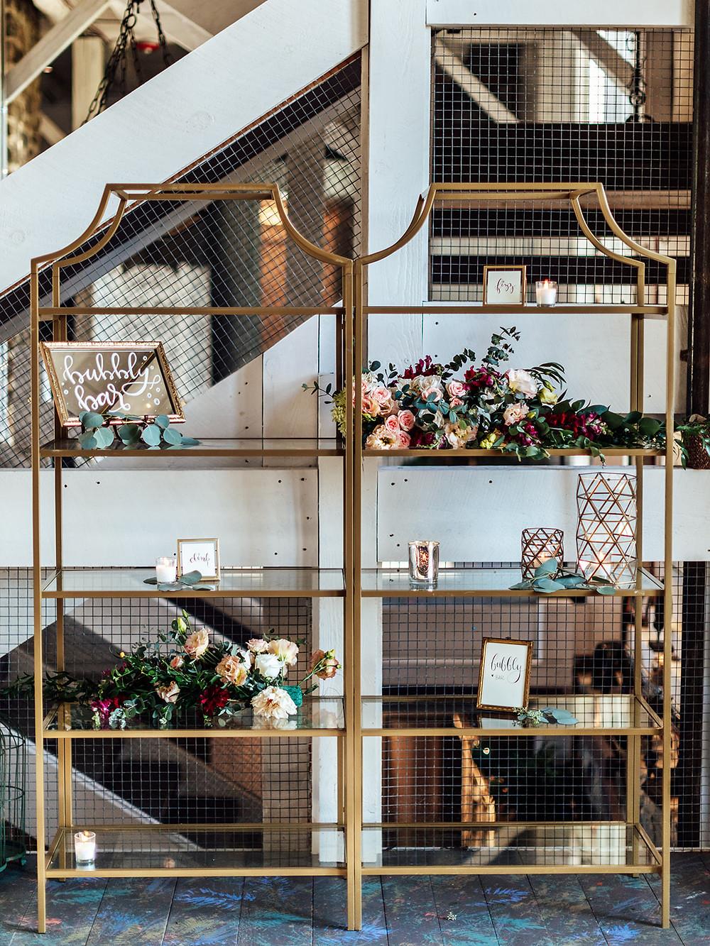 Wedding champagne bar display: Vintage Glam Barn Wedding at The Treman Center