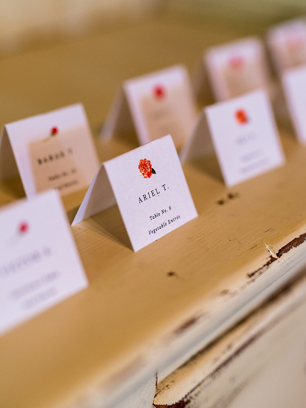 Simple wedding escort cards: Whimsically Rustic Wedding at Grace & Gratitude with vintage decor by Pretty Little Vintage Co.