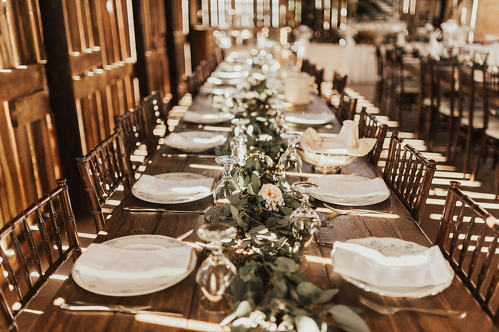 Rustic Farm Table with Greenery Table Runner: Charming Bohemian Gilbertsville Farmhouse Wedding captured by Rachel Liz Photography featured on Pretty Little Vintage Co