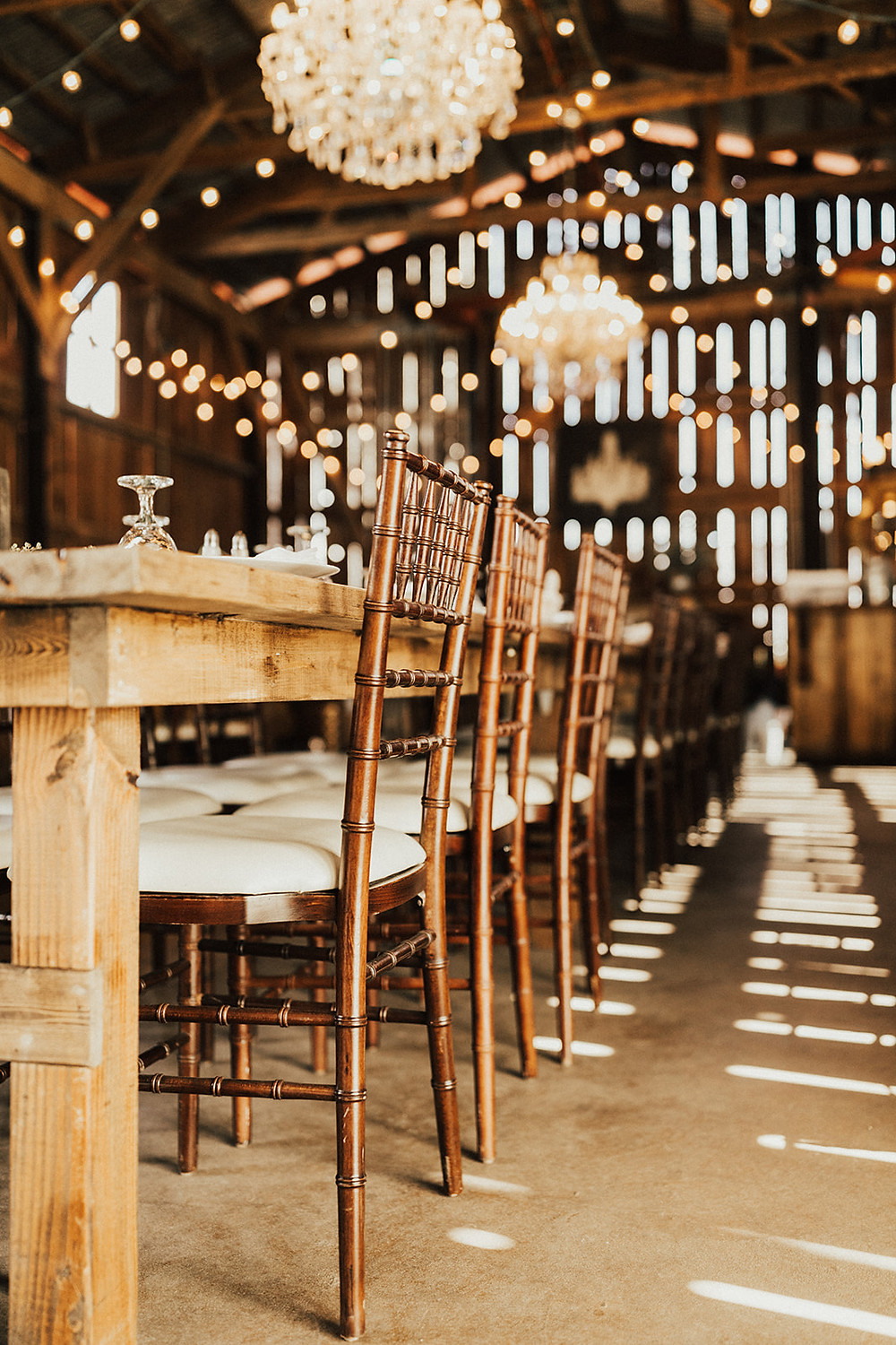 Chiavari Fruitwood Chairs: Charming Bohemian Gilbertsville Farmhouse Wedding captured by Rachel Liz Photography featured on Pretty Little Vintage Co