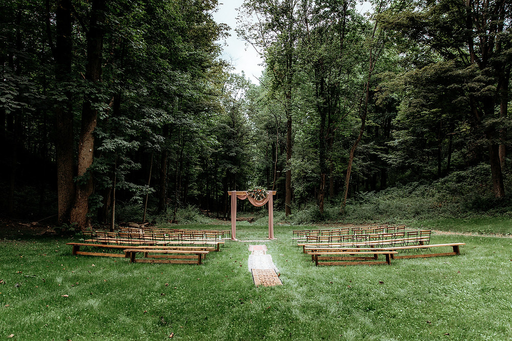 Outdoor wedding ceremony: Warm Toned Backyard Wedding on Skaneateles Lake in Spafford, NY featured on Pretty Little Vintage Co.