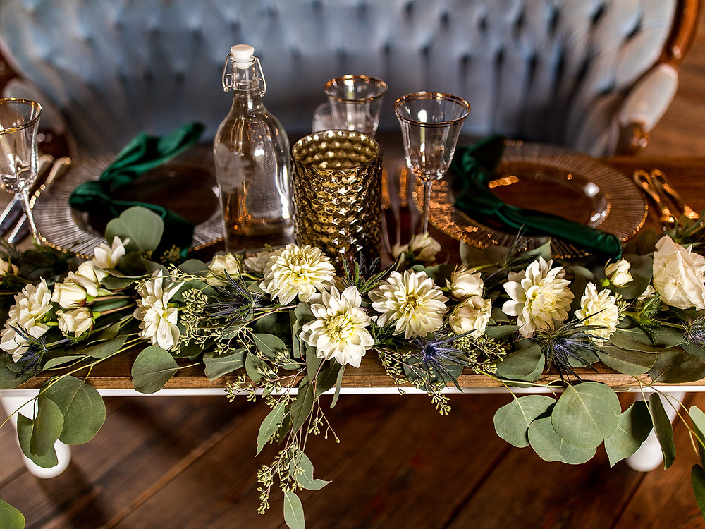 Wedding centerpieces: Whimsically Rustic Wedding at Grace & Gratitude with vintage decor by Pretty Little Vintage Co.