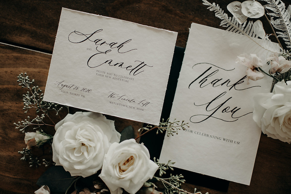 Organic wedding invitations with black script font