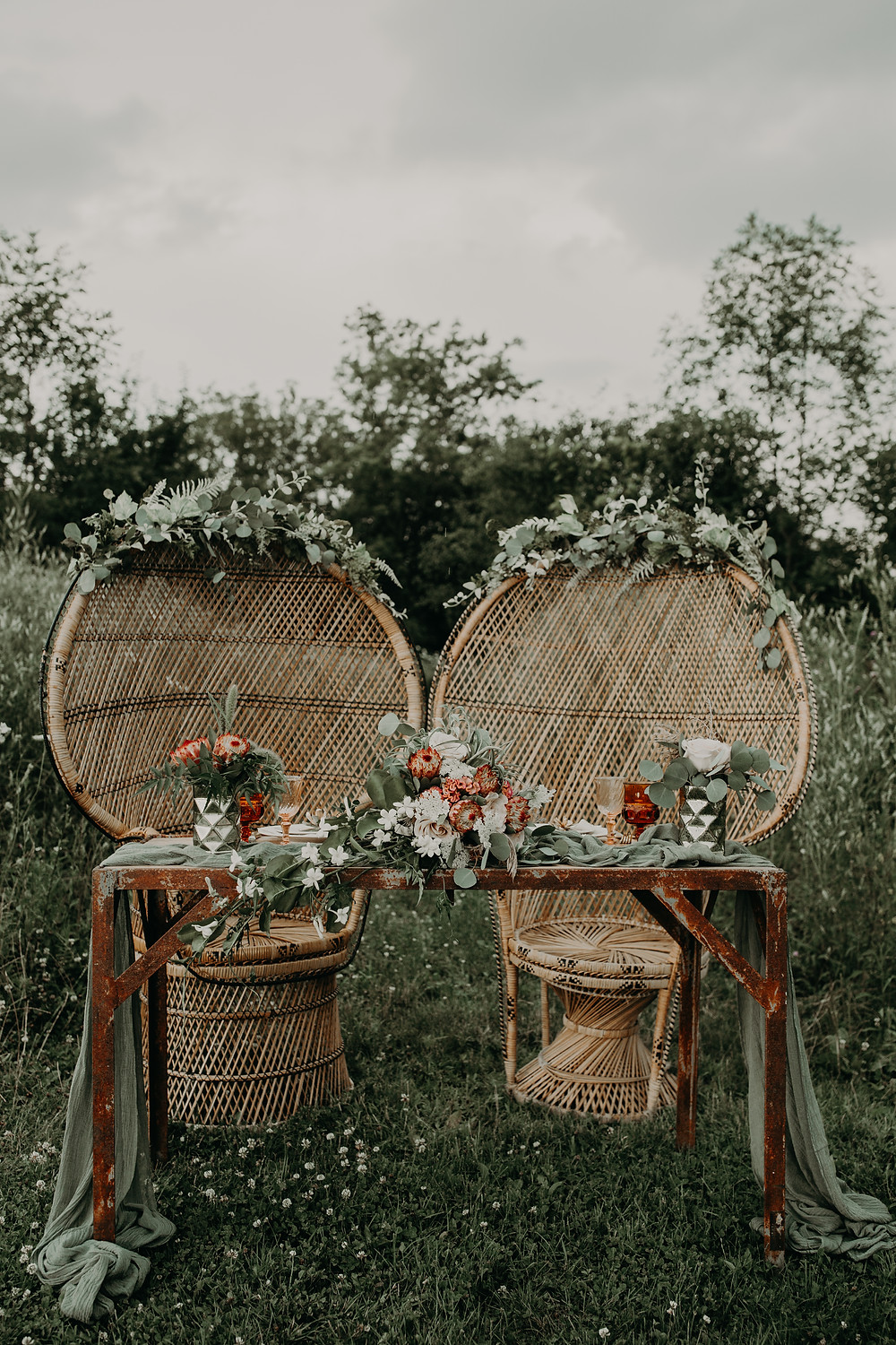 Peacock sweetheart table chairs: Boho TerraCotta Wedding Styled Shoot at Red Barn 20