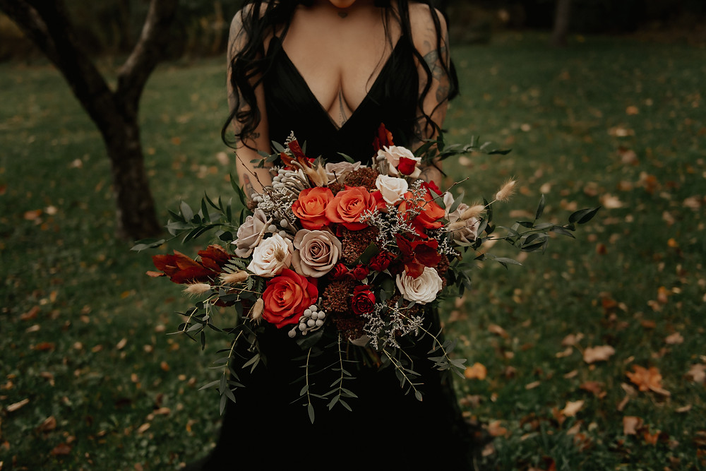 Orange and red fall wedding bouquet: Dark & Romantic Wedding Inspiration featured on Pretty Little Vintage Co.