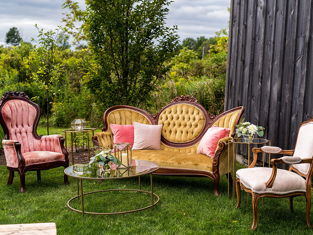 Outdoor wedding lounge: Whimsically Rustic Wedding at Grace & Gratitude with vintage decor by Pretty Little Vintage Co.