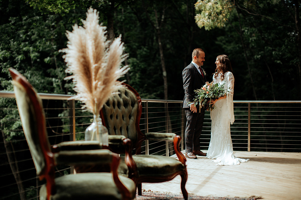 Wedding first look: Warm Toned Backyard Wedding on Skaneateles Lake in Spafford, NY featured on Pretty Little Vintage Co.