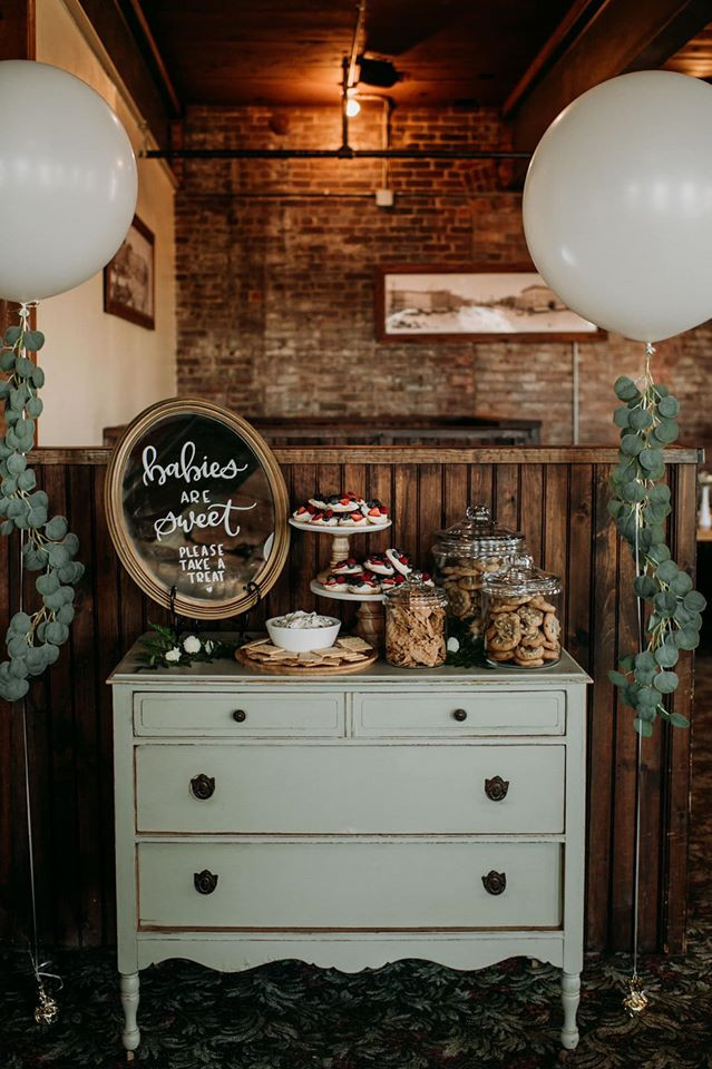 Sage display dessert table; Modern Greenery Baby Shower at Maggie's on the River featured on Pretty Little Vintage Co.