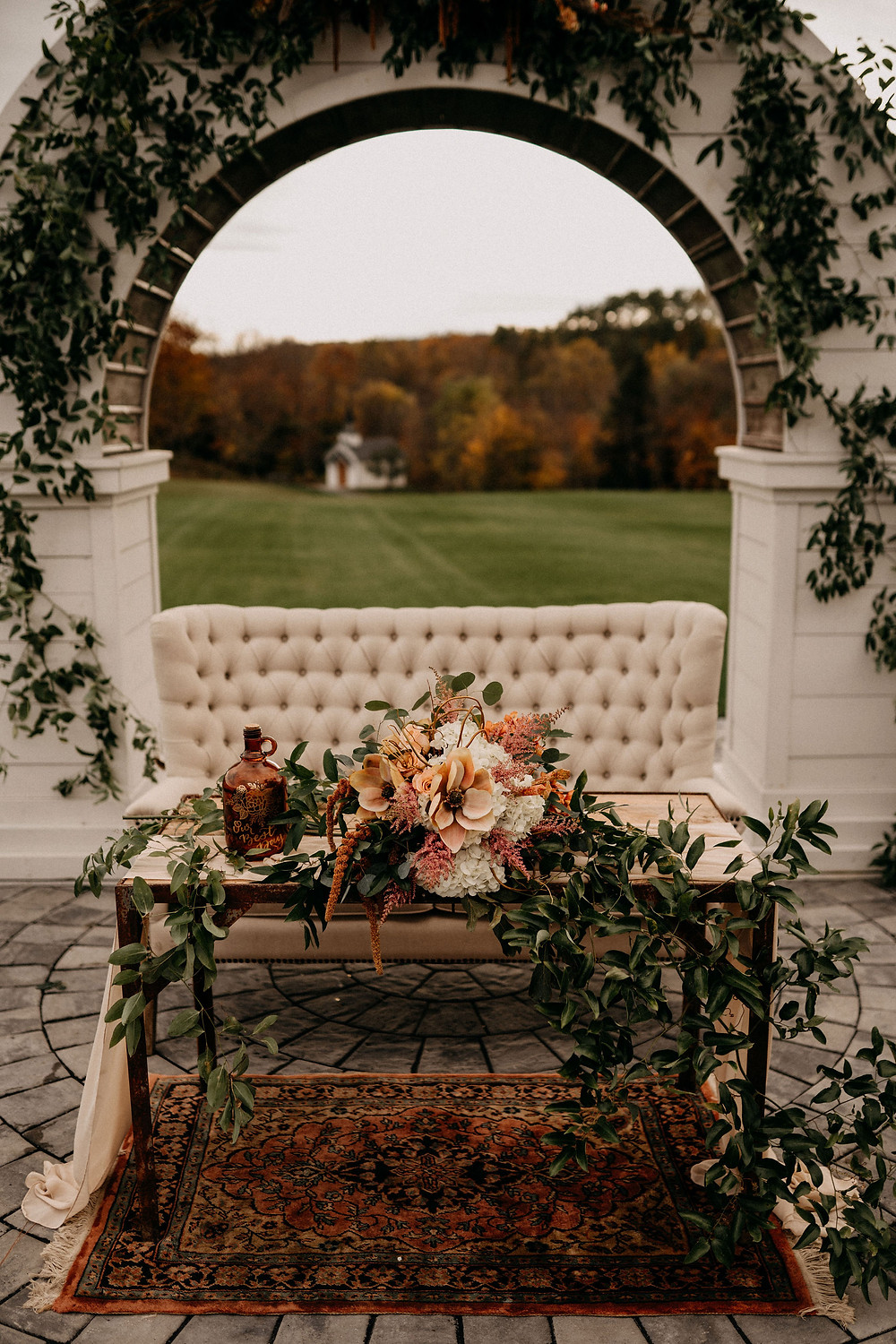 Outdoor Wedding Sweetheart Table: Warm & Rustic Styled Shoot at Hayloft in the Arch captured by Tracy Jade Photography featured on Pretty Little Vintage Co.