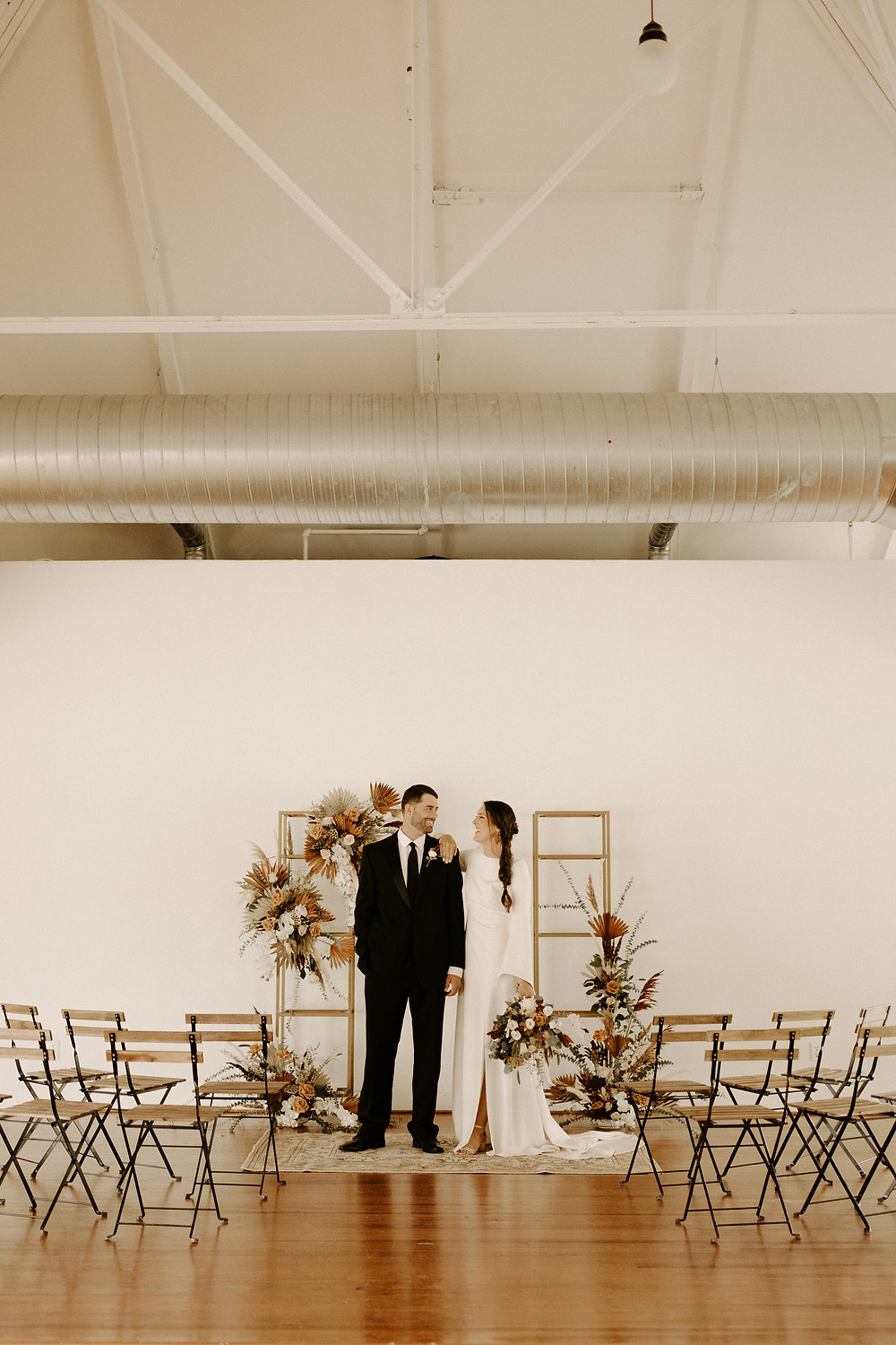 Modern boho wedding ceremony setup