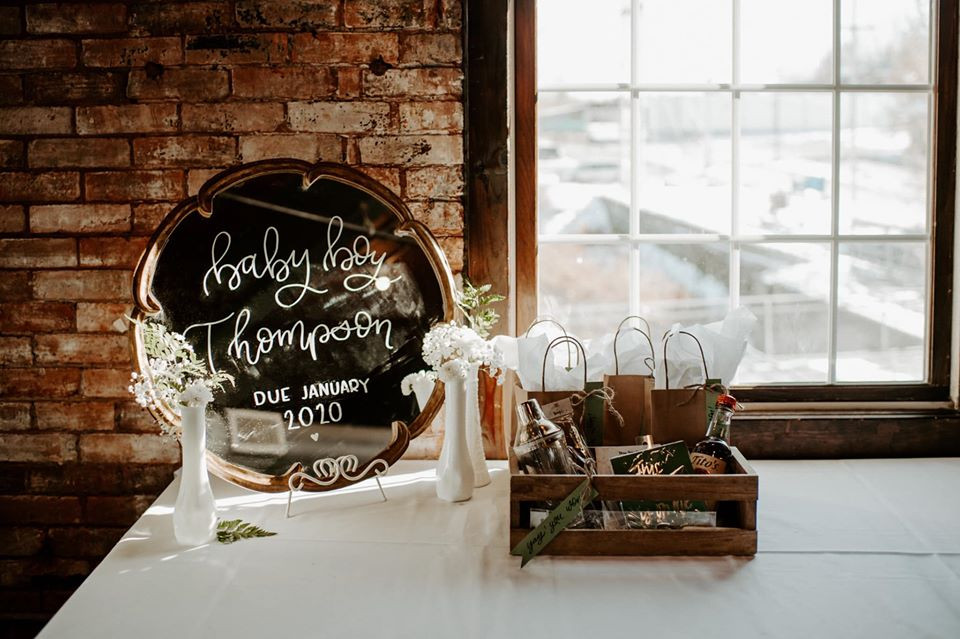 Vintage mirror sign: Modern Greenery Baby Shower at Maggie's on the River featured on Pretty Little Vintage Co.