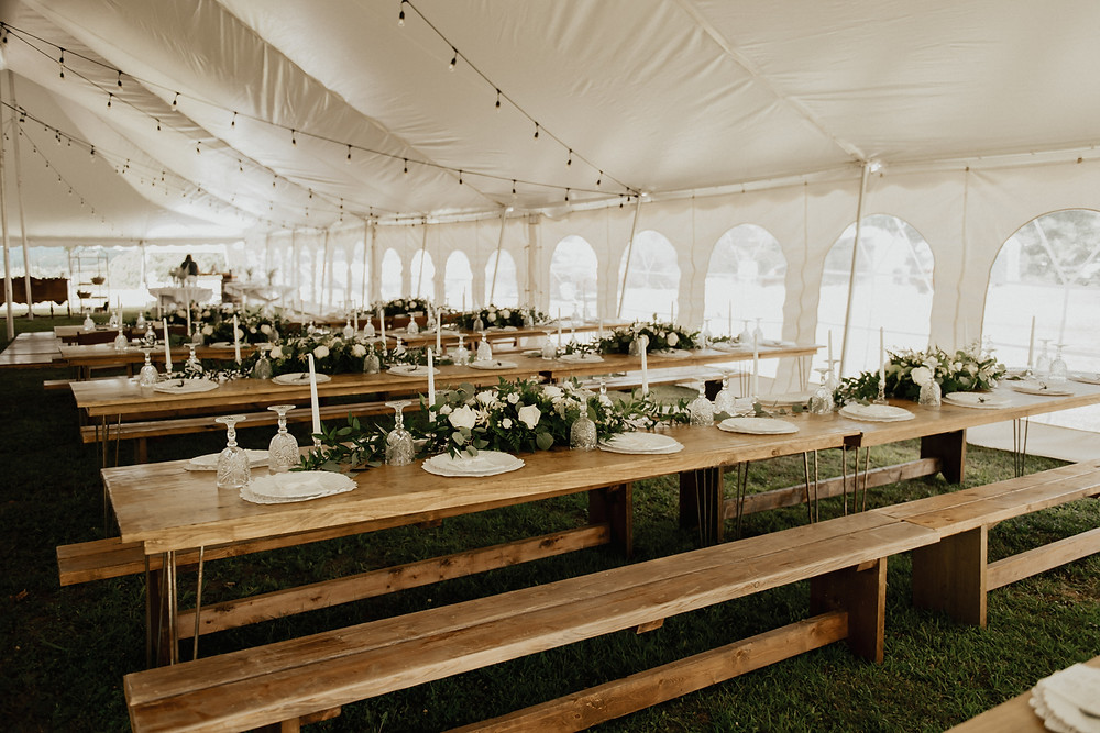 Hairpin family style wedding tables with wood benches