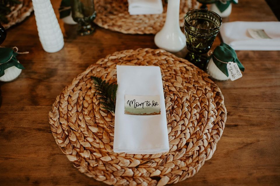 Braided chargers plates: Modern Greenery Baby Shower at Maggie's on the River featured on Pretty Little Vintage Co.