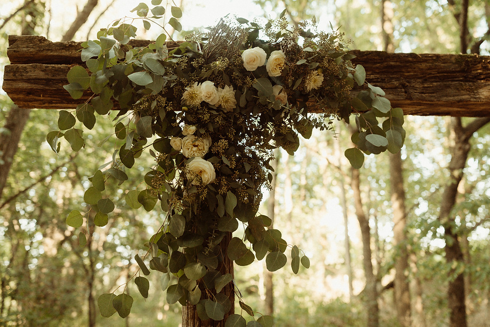 Wood Arbor with Greenery and White Wedding Flowers