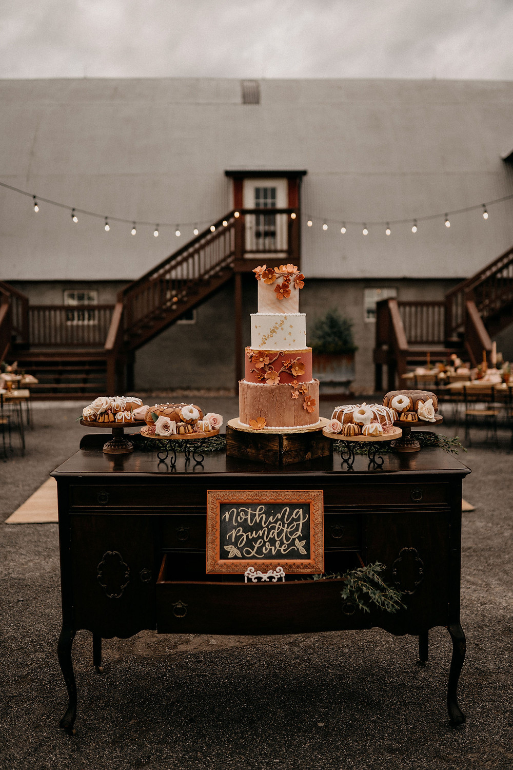 Outdoor Wedding Cake Display: Warm & Rustic Styled Shoot at Hayloft in the Arch captured by Tracy Jade Photography featured on Pretty Little Vintage Co.
