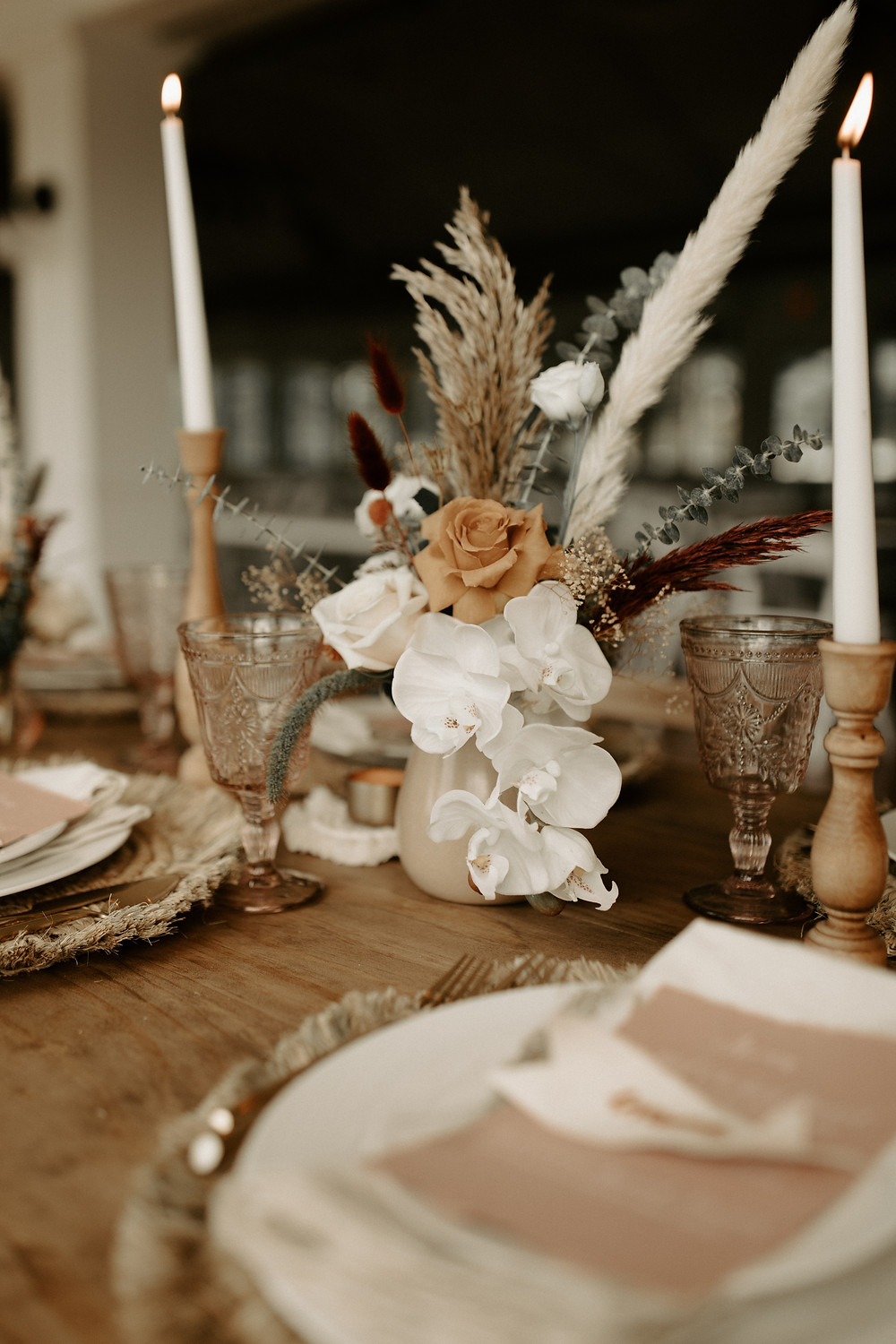 White and orange wedding centerpieces