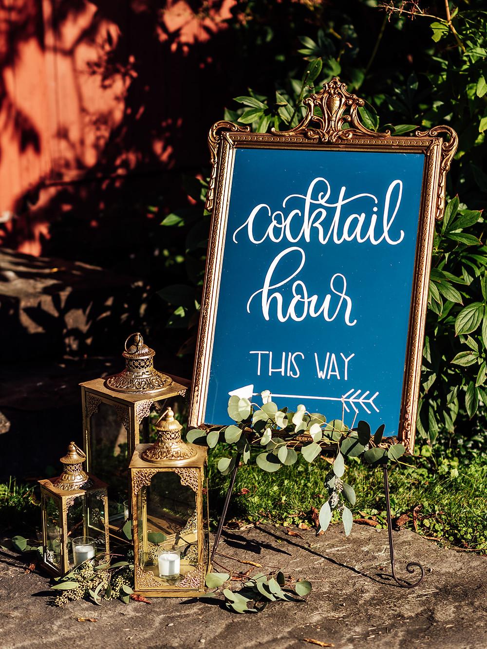 Gold hand-lettered cocktail hour sign: Vintage Glam Barn Wedding at The Treman Center