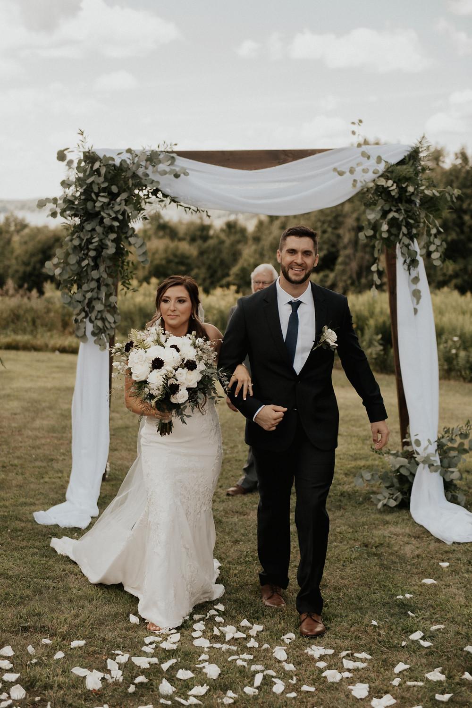 Wooden arbor wedding ceremony backdrop