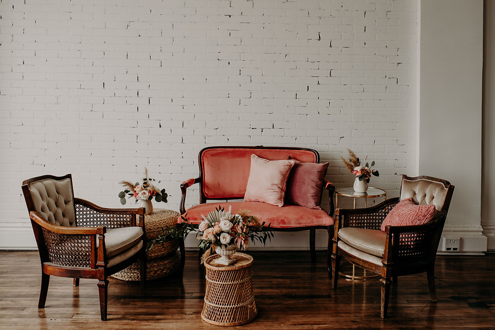 Peach settee lounge area: Citrus Colored Baby Shower Inspiration with Pretty Little Vintage Co.