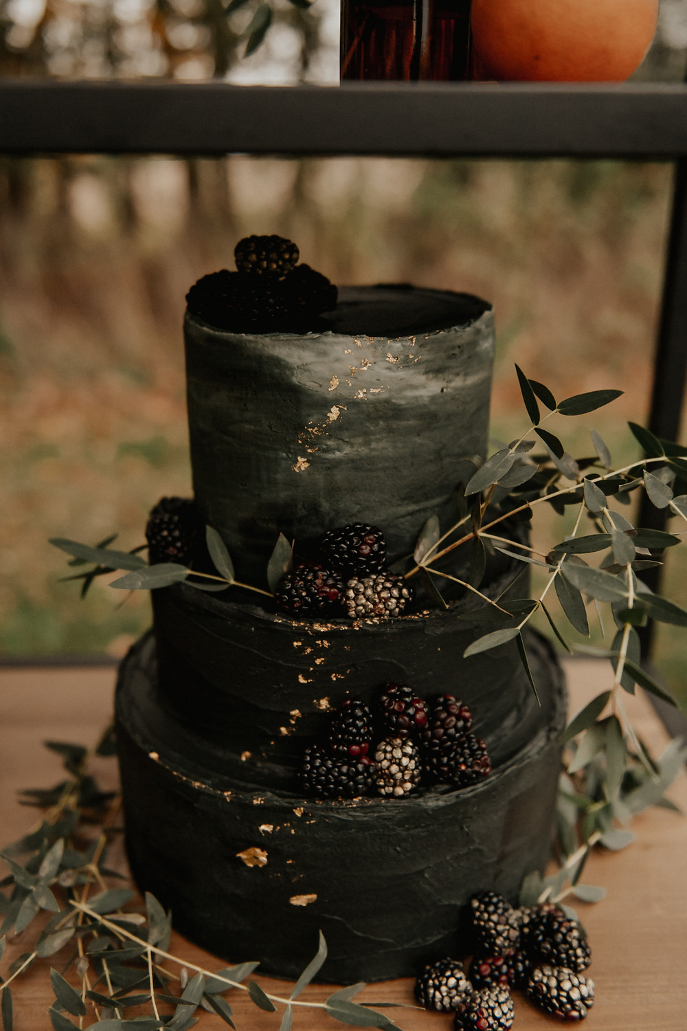 Black wedding cake with gold foil: Dark & Romantic Wedding Inspiration featured on Pretty Little Vintage Co.