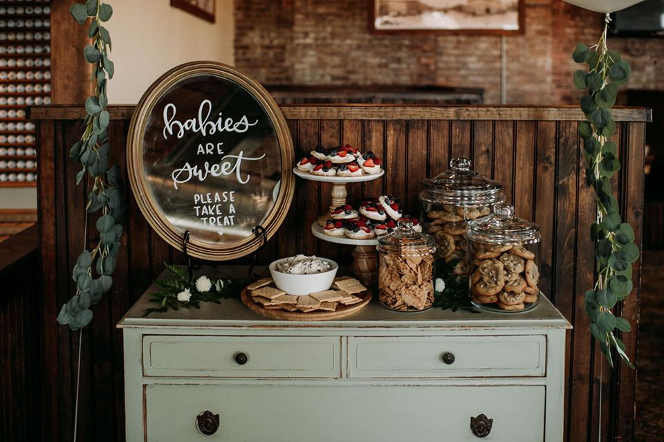 Baby shower dessert table: Modern Greenery Baby Shower at Maggie's on the River featured on Pretty Little Vintage Co.