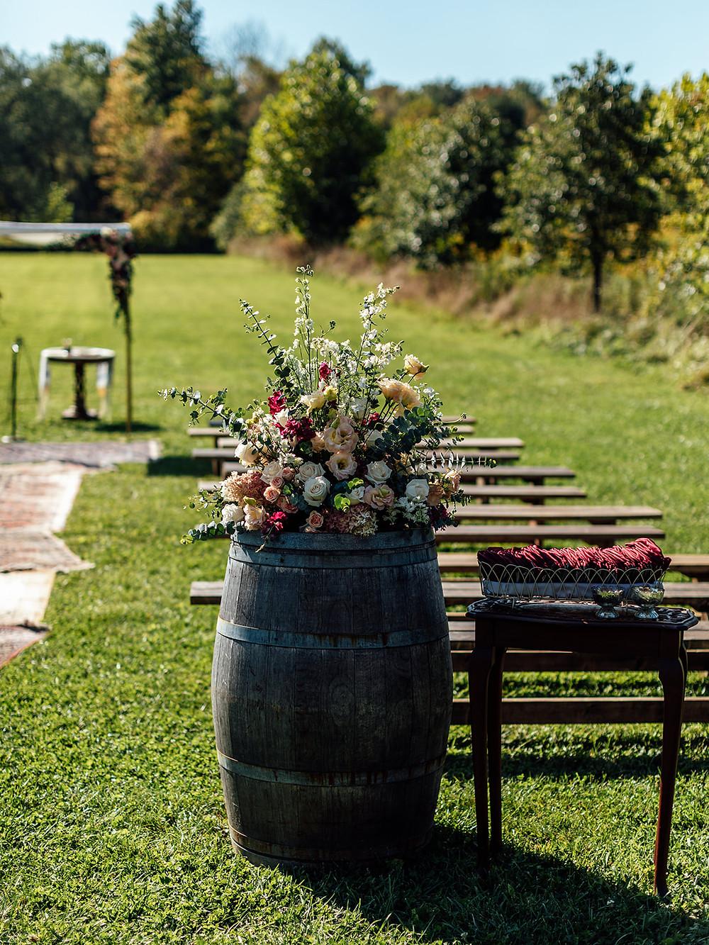 Outdoor wedding ceremony barrel decor: Vintage Glam Barn Wedding at The Treman Center