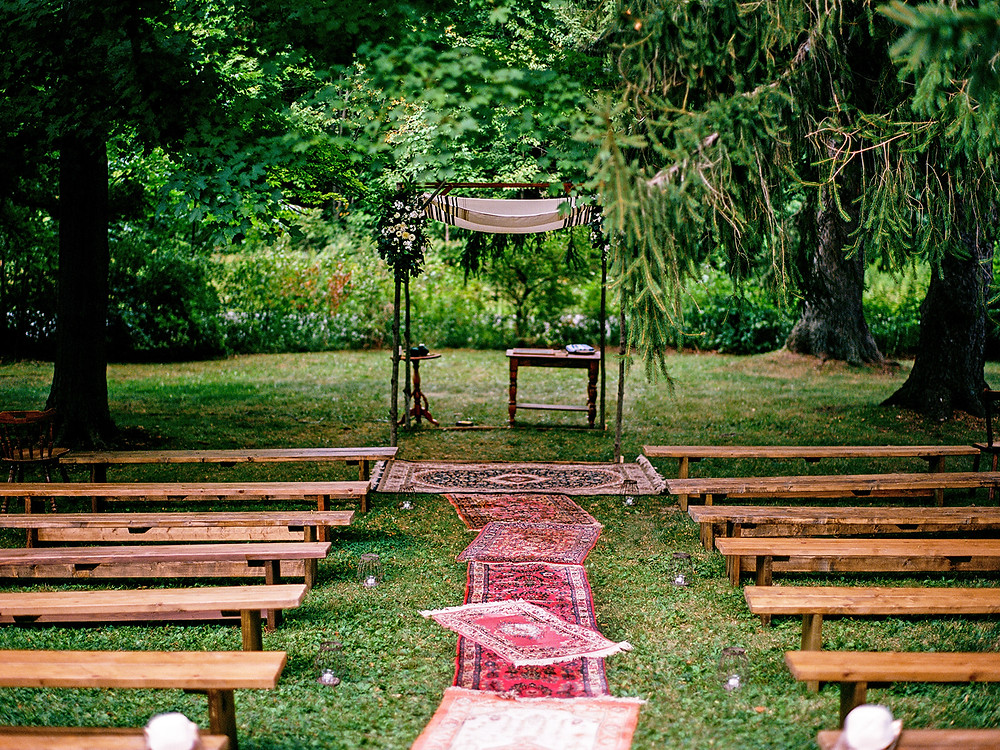 Outdoor wedding ceremony: Whimsically Rustic Wedding at Grace & Gratitude with vintage decor by Pretty Little Vintage Co.